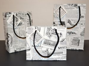 Vintage newspaper ad Wallpaper used as gift bags!