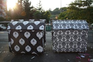 City dumpsters made pretty with wallpaper